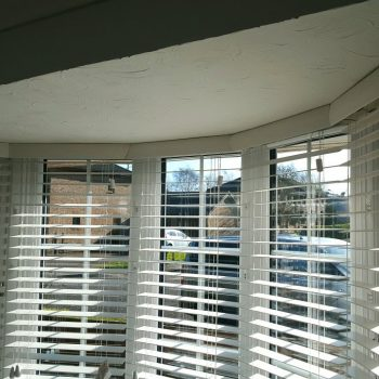 Faux Wood Venetian Blinds In Bay Window